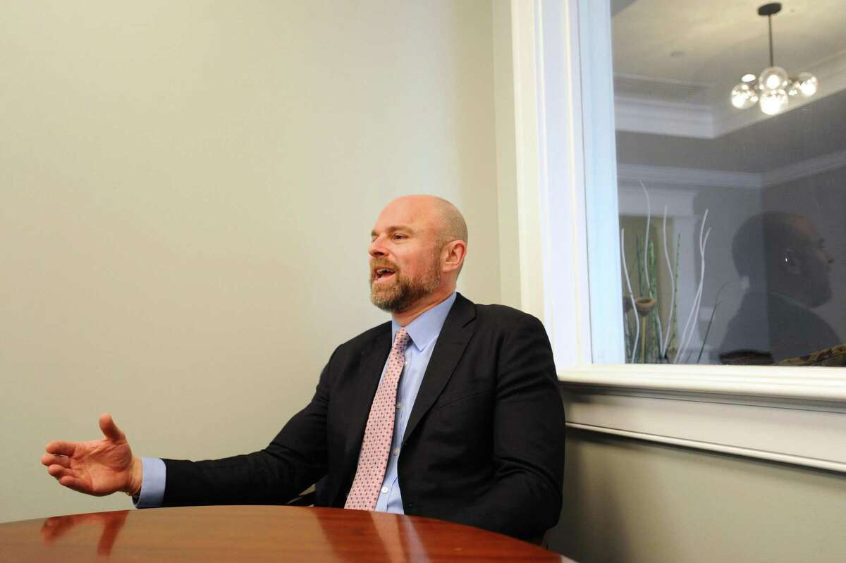 Scott Skorobohaty, executive vice president of community banking and commercial lending at Laurel Road, makes a point during an interview at Laurel Road's branch at 1001 Post Road in Darien, Conn., on April 18, 2018.