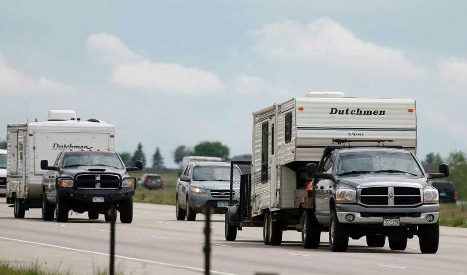 FILE - In this May 27, 2016, file photo, motorists guide their vehicles northbound on Interstate 25 to mark the start of the Memorial Day weekend near Firestone, Colo. Suddenly road trips are trendy again. Surveys from MMGY, Ford and AAA show their popularity is up. Websites, newspapers, magazines and even books are featuring road trips like they're the next big thing _ even though they're actually a longstanding American tradition. (AP Photo/David Zalubowski, File) Photo: David Zalubowski / Copyright 2018 The Associated Press. All rights reserved.