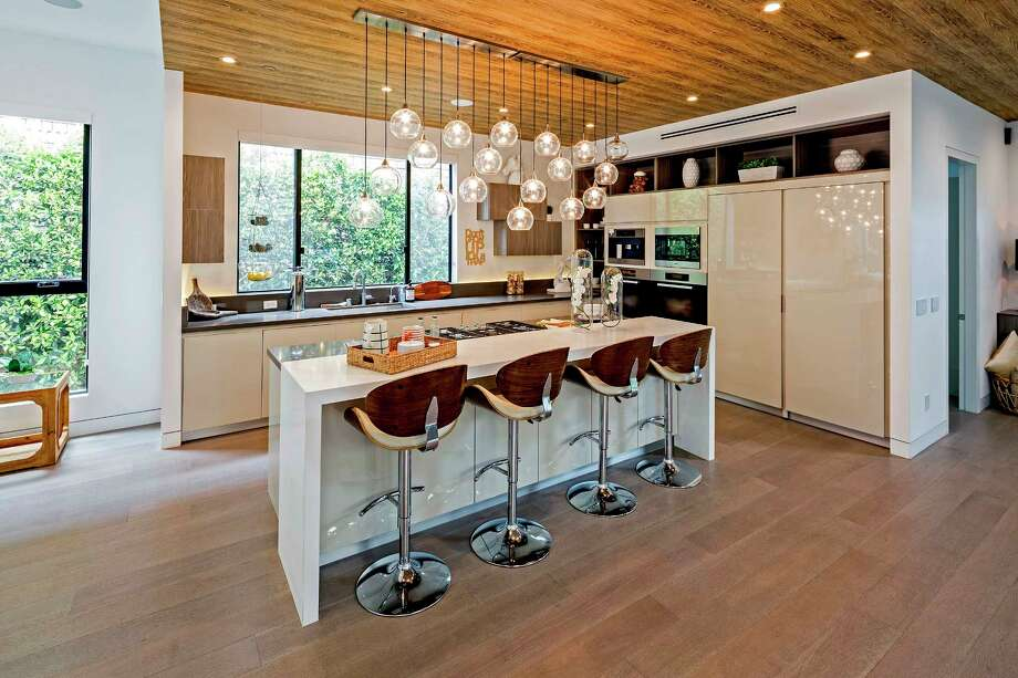 Model and TV personality Tyra Banks is also seeking $4.25 million for another Pacific Palisades, Calif., home, which features a vibrant wood paneling and an updated kitchen, among other things. (David Zaitz Photography/TNS) Photo: David Zaitz Photography / Los Angeles Times