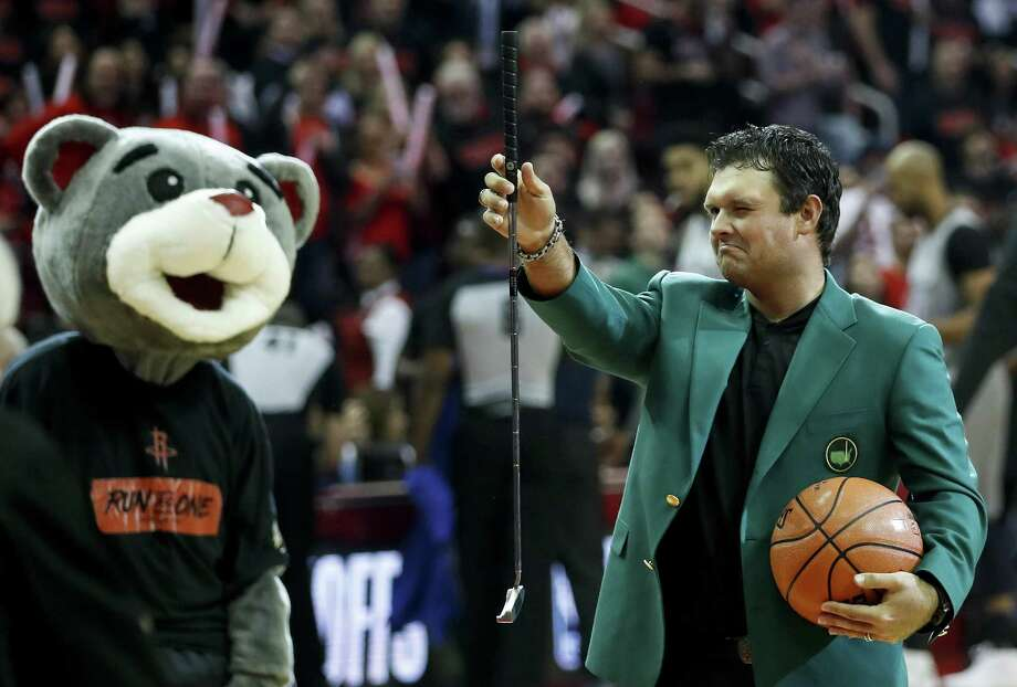 """Masters Champion Patrick Reed lines up the """"first shot"""" before Game 1 of an NBA basketball first-round playoff series between the Houston Rockets and the Minnesota Timberwolves at Toyota Center on Sunday, April 15, 2018, in Houston. ( Brett Coomer / Houston Chronicle ) Photo: Brett Coomer, Staff / Houston Chronicle / © 2018 Houston Chronicle"""