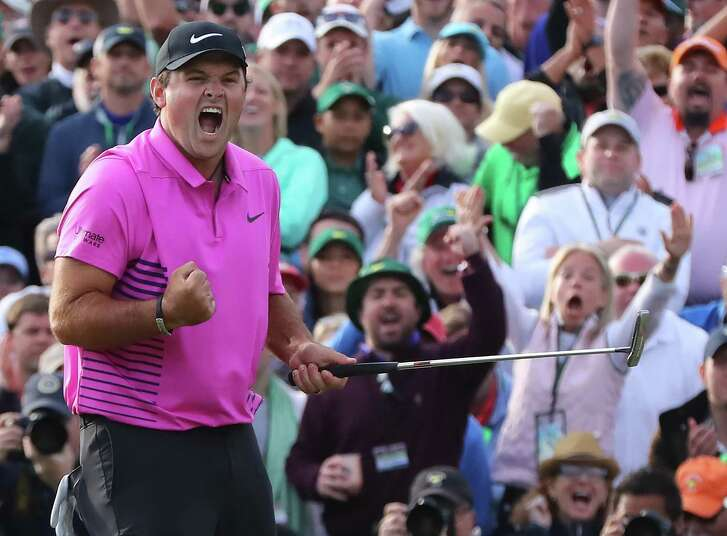 Patrick Reed makes a par putt on the 18th green to win the Masters at 15-under par at Augusta National Golf Club on Sunday, April 8, 2018, in Augusta, Ga. (Curtis Compton/Atlanta Journal-Constitution/TNS)