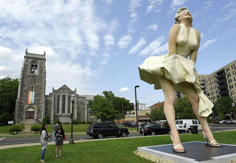 """Marilyn Monroe's iconic pose in front of Stamford church draws mixed reactions This summer, the Stamford summer arts series brought in one of their most iconic (and contentious) sculptures - a 26-foot tall, 30,000-pound Marilyn Monroe, striking a pose from the now-famous film, """"The Seven Year Itch."""" Sounds great, but the problem? The risqué statue stood directly across the street from Stamford's First Congregational Church, which prompted a harsh reactions from parishioners who found the statue's placement, """"disrespectful to the church."""" Read more.Follow the whole story in the links below:30,000 pounds of Marilyn Monroe descend on Stamford 