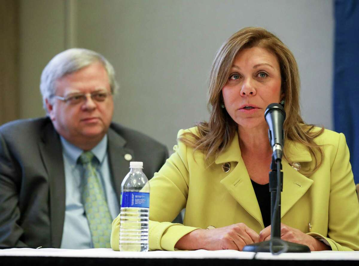 State Sen. Joan Huffman, right, and state Sen. Paul Bettencourt are seen during a press conference at the Westin Galleria hotel Jan. 16, 2018, in Houston. The Legislature passed a bill by Huffman that would require home sellers to disclose when a property is located within a flood-prone area. Bettencourt co-authored a bill that would protect victims of Harvey and future storms from seeing sudden jumps in their property tax bills.