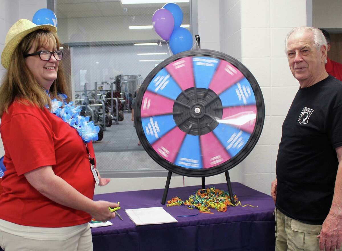 YMCApatron DonMadere (right) spins the prize wheel as Stacie Dawson, database specialist at the YMCA of Greater Houston (left) watches, during the Lake Houston Family YMCA's reopening day on Monday, June4, in Kingwood.