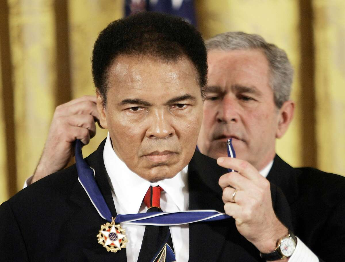 FILE - In this Nov. 2009 file photo, President Bush presents the Presidential Medal of Freedom to boxer Muhammad Ali in the East Room of the White House. President Donald Trump said he is thinking