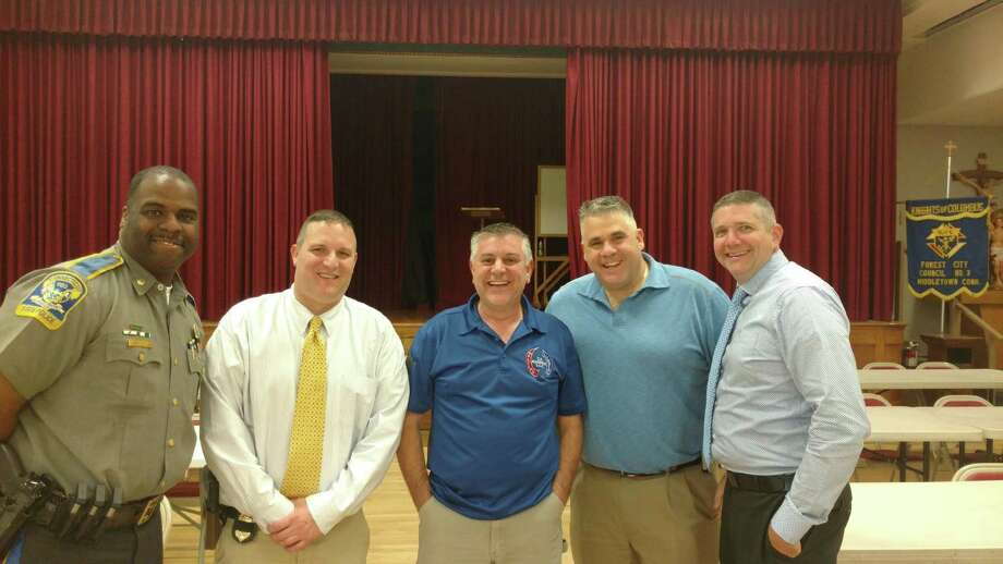 From left are Connecticut State Police Maj. Michael Davis and Sgt. Bryan Ferruci, plumbing contractor Carmelo Magnano, Lt. Col. Starvos Mellekas and Sgt. Ian Sacks. Photo: Contributed Photo
