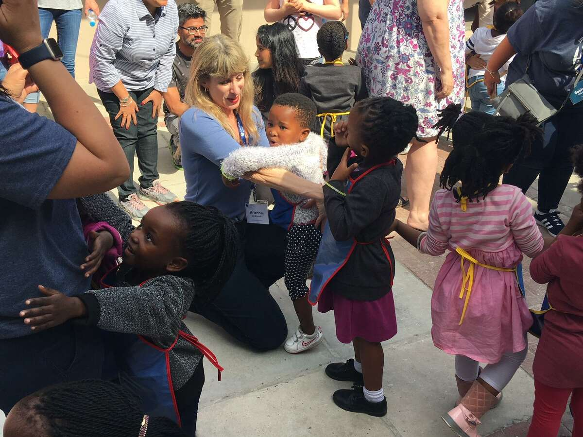 Arienne hugs students at the Molo Mhlaba school in Cape Town, South Africa.