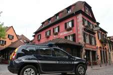 "A vehicle of the French Gendarmerie drives past the Chambard hotel on June 8, 2018 in the eastern France region of Alsace village of Kaysersberg, where US food author and travel host Anthony Bourdain hang himself while travelling in France. - Anthony Bourdain, the American celebrity chef and author whose popular television shows explored the diversity of the world's food and cultures, has committed suicide at the age of 61. Bourdain was found dead in his hotel room in France, where he was filming an episode of his Emmy-winning CNN program ""Parts Unknown,"" the network said Friday. (Photo by Frederick FLORIN / AFP)        (Photo credit should read FREDERICK FLORIN/AFP/Getty Images)"