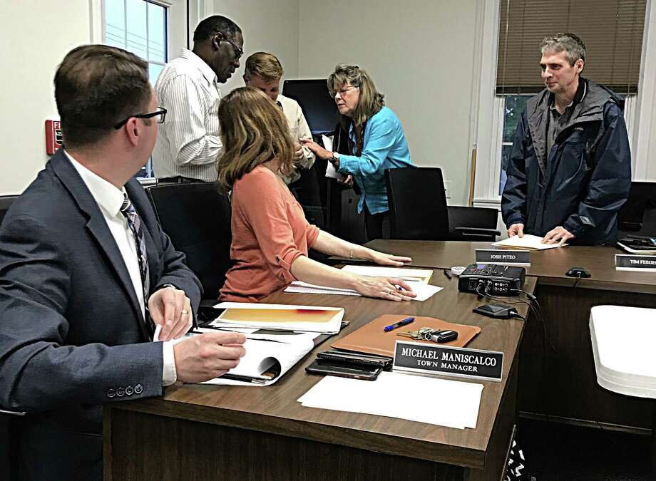 East Hampton Town Manager Michael Maniscalco, left, discusses the town's proposed budget with town councilors. Photo: File Photo