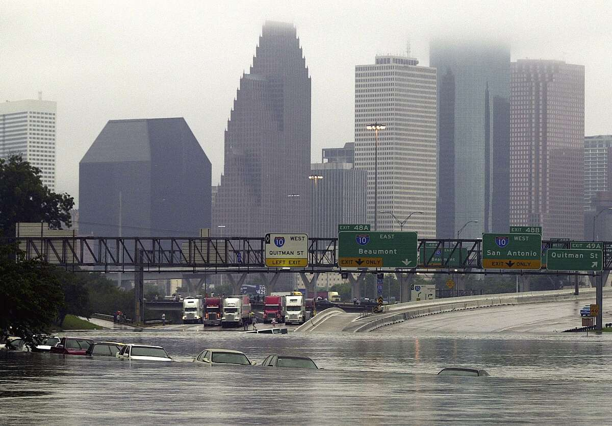 Overflow from White Oak Bayou spilled onto Interstate 45 near Quitman Street onafter remnants of Tropical Storm Allison inundated the city.