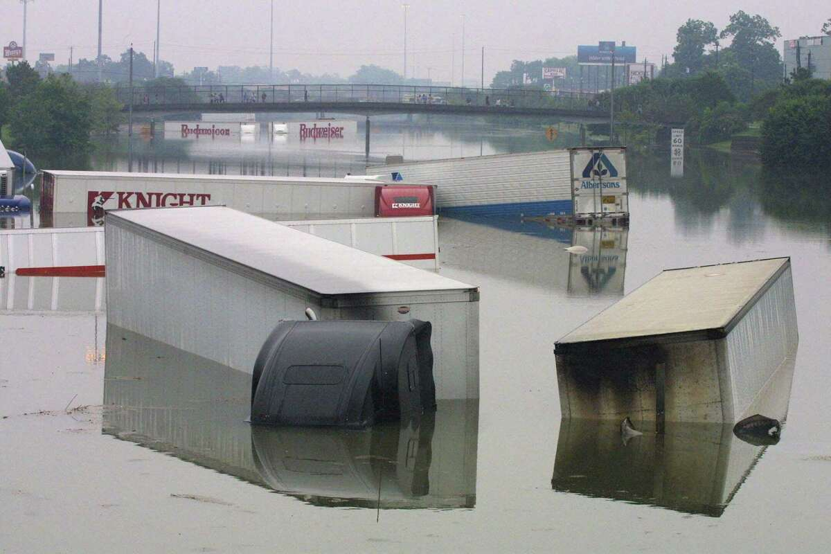 Several trucks float in Interstate highway 10 in Houston Saturday, June 9, 2001. The remnants of tropical storm Allison dumped over 40 inches of rain in the area in one week. (AP Photo / Michael Stravato)