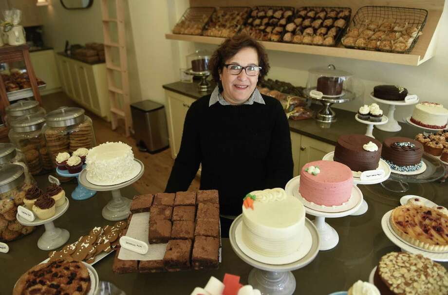 Owner Helene Godin poses behind the counter at By the Way Bakery in Greenwich, Conn. Wednesday, Dec. 21, 2016. Located at 19 E. Putnam Ave., the bakery serves a variety of pastries, cakes and other baked goods. Photo: Tyler Sizemore / Hearst Connecticut Media / Greenwich Time