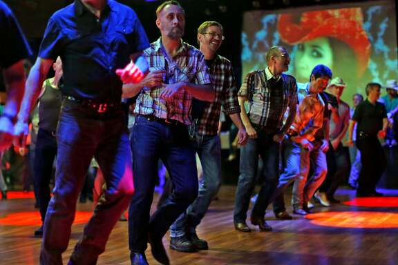 Gay Bay Area country fans dance at Sundance Saloon in San Francisco, Calif., on Sunday, November 30, 2014.