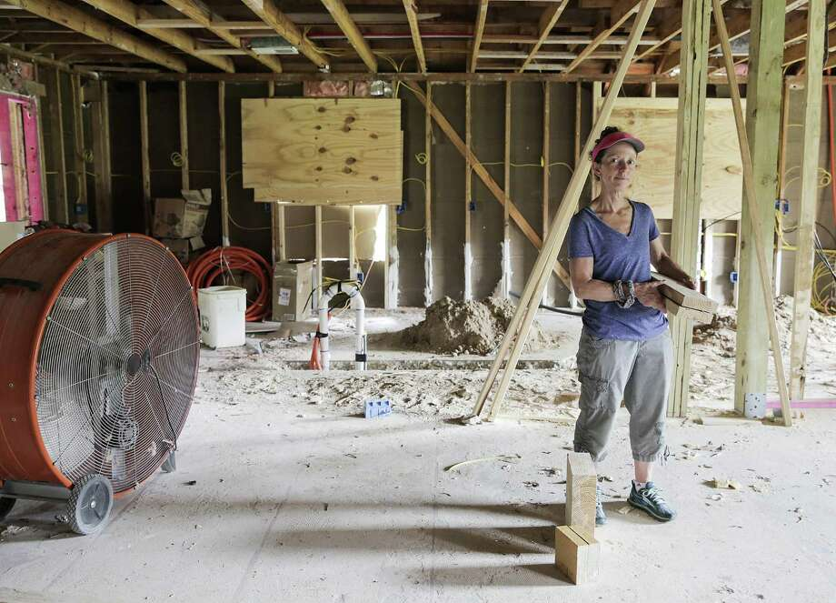 Monica Daly stands in her Pearland home that was damaged by Hurricane Harvey. She has filed a lawsuit accusing her contractor of shoddy work. She is shown here on May 23, 2018. Photo: Elizabeth Conley, Chronicle / Houston Chronicle / ©2018 Houston Chronicle