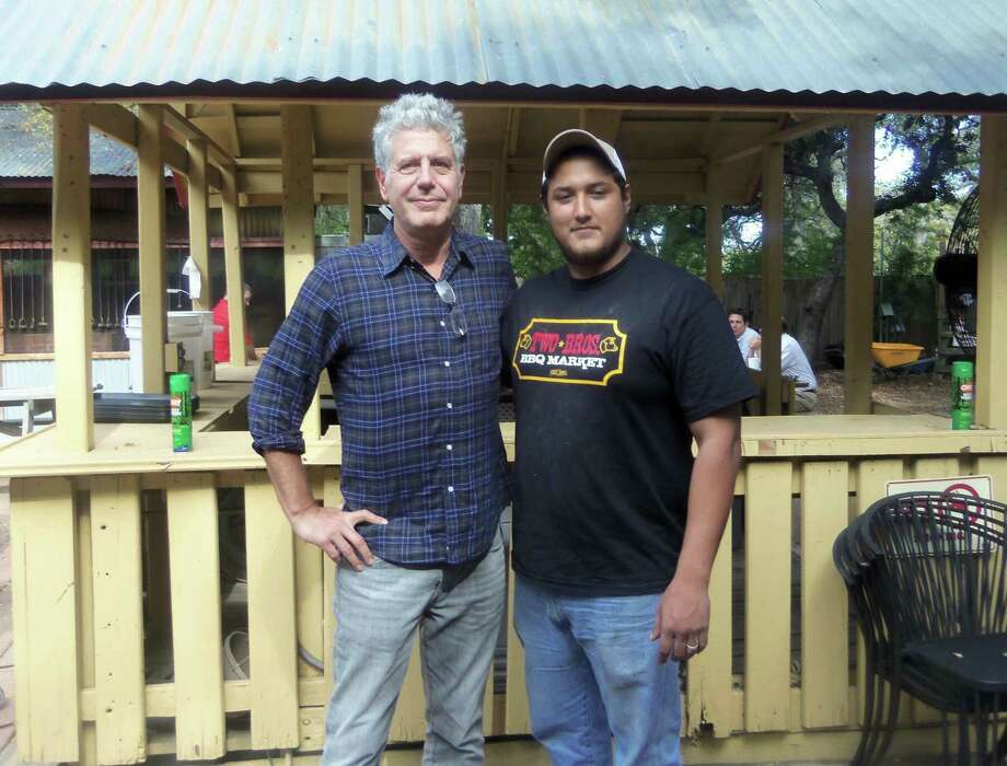 Anthony Bourdain made a stop in San Antonio in 2012 as part of a speaking tour and chose to eat lunch at Two Bros. BBQ Market. There he shared a beer with pitmaster Emilio Soliz and was a fan of the brisket and ribs. Photo: Courtesy Emilio Soliz