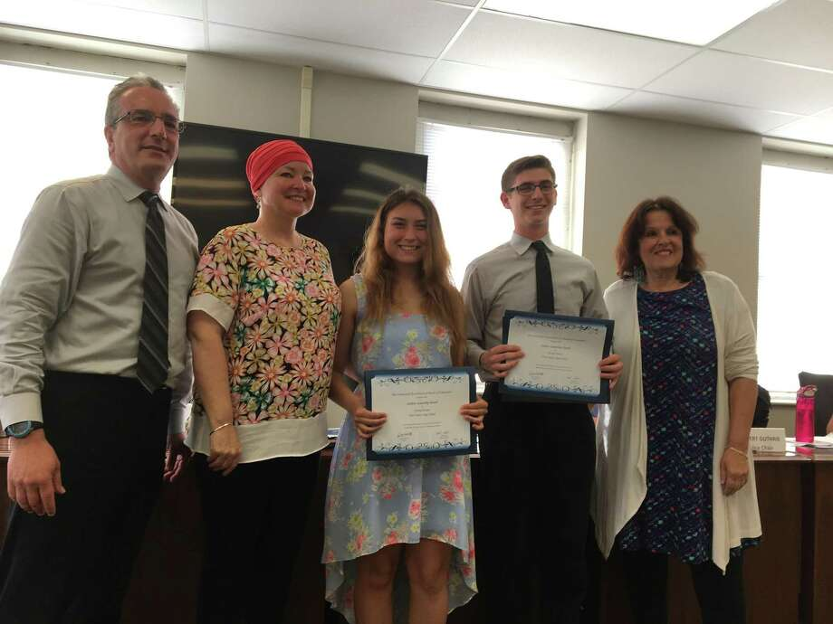 The West Haven Board of Education honored graduating West Haven High School seniors Hailey Parsons and David O'Brien on Monday night, June 4 as recipients of the 21st Annual CABE Student Leadership Awards. Pictured, from left, are Superintendent of Schools Neil Cavallaro, West Haven High School Principal Pamela Gardner, Parsons, O'Brien and Board of Education Chairwoman Rosemary Russo. Photo: Mark Zaretsky / Hearts Connecticut Media