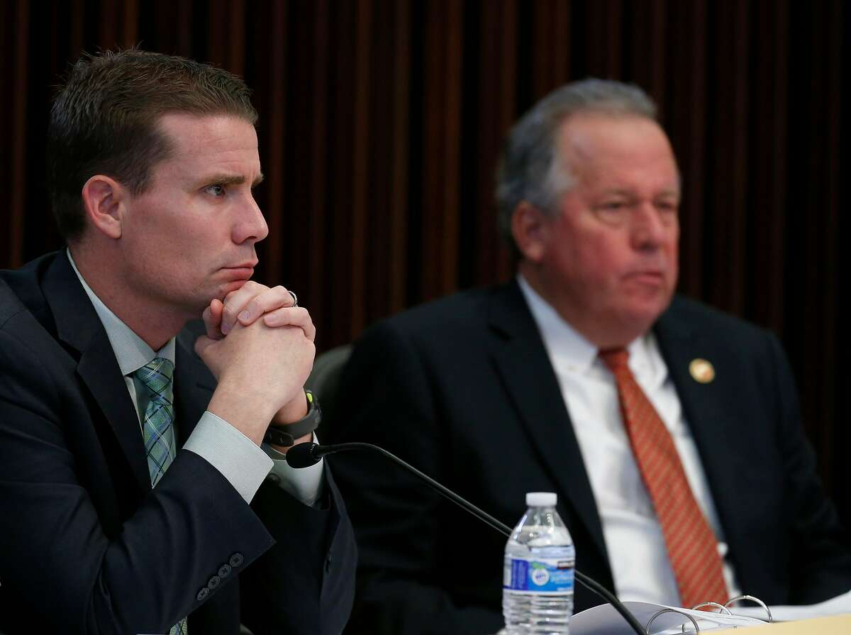 State Sens. Mike McGuire (left) and Bill Dodd listen to testimony from Cal Fire Chief Ken Pimlott during a hearing of the Senate Energy, Utilities and Communications subcommittee on gas, electric and transportation safety in Santa Rosa, Calif. on Friday, Jan. 26, 2018.