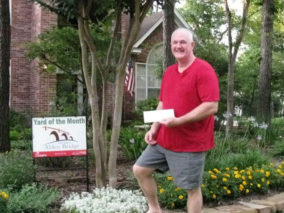 The Alden Bridge Village Association presented the June Yard of the Month award to the McClelland family of Churchdale Place. Pictured here is homeowner Mark McClelland. Photo: Courtesy Photo