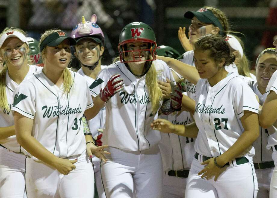 The Woodlands' Amanda Curran reacts after hitting a solo home run during the fifth inning of Game 1 in a Region II-6A quarterfinal series on Thursday, May 10, 2018, in The Woodlands. The Woodlands defeated Rockwall 2-1. Photo: Jason Fochtman, Staff Photographer / Houston Chronicle / © 2018 Houston Chronicle