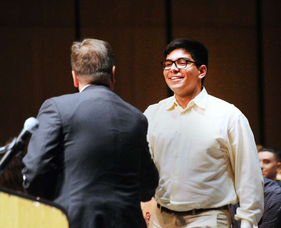 Greenwich High School senior Felipe Sanches receives the James Branca Memorial - Republican Town Committee Scholarship from Greenwich First Selectman Peter Tesei during the Greenwich Scholarship Association's 46th annual Scholarship Evening at Greenwich High School, Thursday, June 7, 2018. Sanches will be attending UConn Storrs in the fall. More than $500,000 was awarded by 101 sponsors to 142 graduating Greenwich school seniors. Photo: Bob Luckey Jr. / Hearst Connecticut Media / Greenwich Time