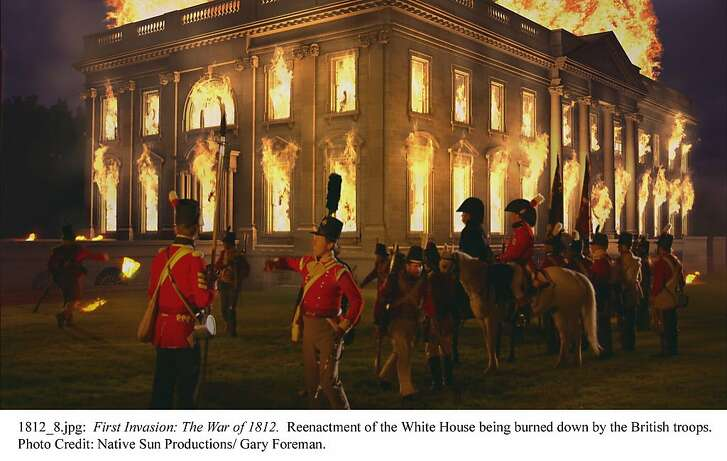 A scene from the History Channel movie 'First Invasion: The War of 1812' shows the White House being burned by British troops.