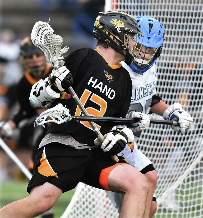 The Hand boys lacrosse team will face top-seeded New Fairfield in the Class M championship game on Saturday. Photo: Catherine Avalone / Hearst Connecticut Media / New Haven Register