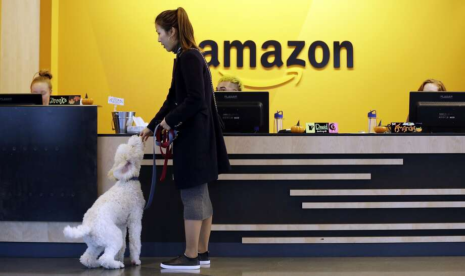Amazon is reportedly weighing New York and Virginia for a split second headquarters, but the Wall Street Journal reports that Dallas remains a contender, too. (AP Photo/Elaine Thompson)  >>> See how Amazon saves on taxes ... Photo: Elaine Thompson, Associated Press