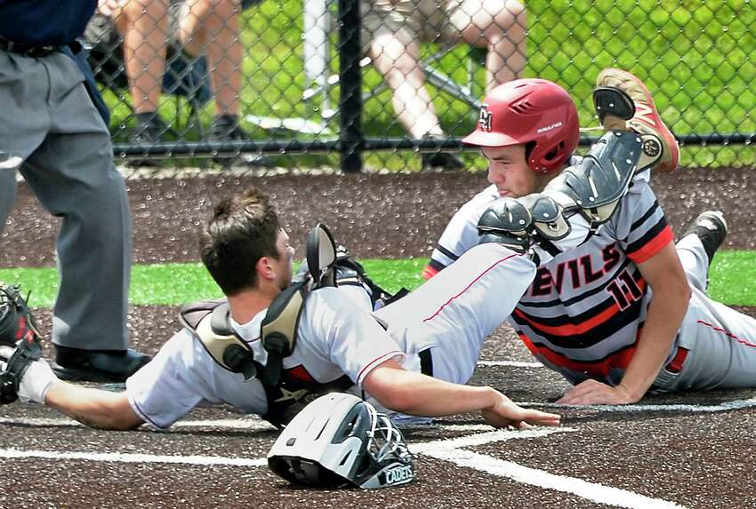 Albany Academy catcher #4 Danny Moshier, left, can't hang on to the ball as Center Moriches' #11 David Falco slides in to score during their Class B Baseball State Semifinal game against Center Moriches Friday June 8, 2018 in Endwell, NY. (John Carl D'Annibale/Times Union)