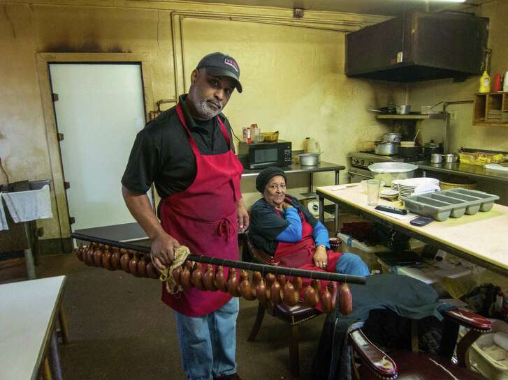 George and his mother Marie Gerard with handmade beef links at Gerard's Bar-B-Q