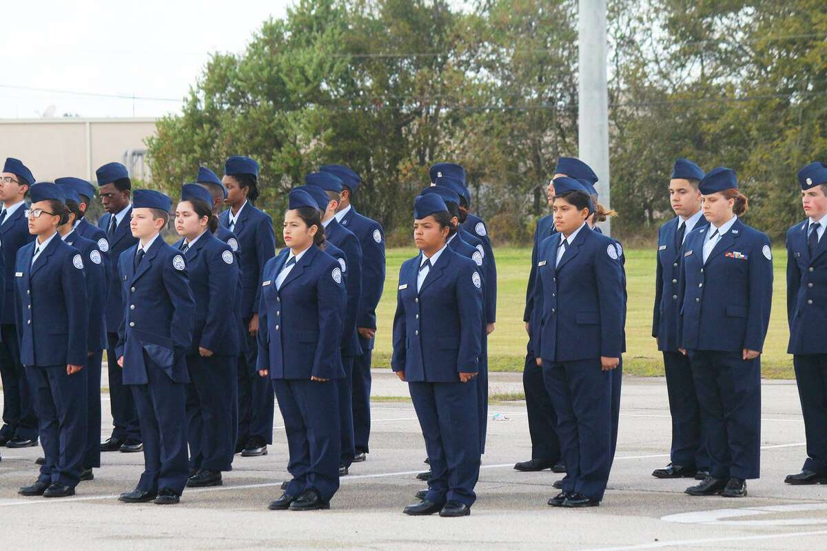 Members of the Lamar Consolidated High School JROTC stand at attention.