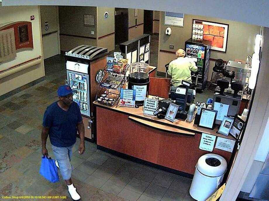 Alton police are seeking assistance in identifying a suspect, left, allegedly involved in a recent theft of a patient's belongings at Alton Memorial Hospital. The suspect is seen holding the stolen bag on inside AMH, on June 6 during the morning hours. Photo:       For The Telegraph