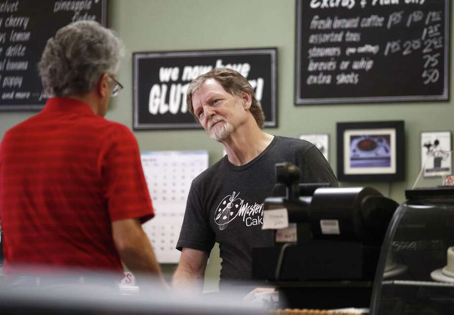 Baker Jack Phillips, owner of Masterpiece Cakeshop, right, manages his shop June 4 in Lakewood, Colo. The Supreme Court ruled Monday in favor of Phillips, who wouldn't make a wedding cake for a same-sex couple, in a limited decision that leaves for another day the larger issue of whether a business can invoke religious objections to refuse service to gay and lesbian people. Photo: David Zalubowski /Associated Press / Copyright 2018 The Associated Press. All rights reserved.