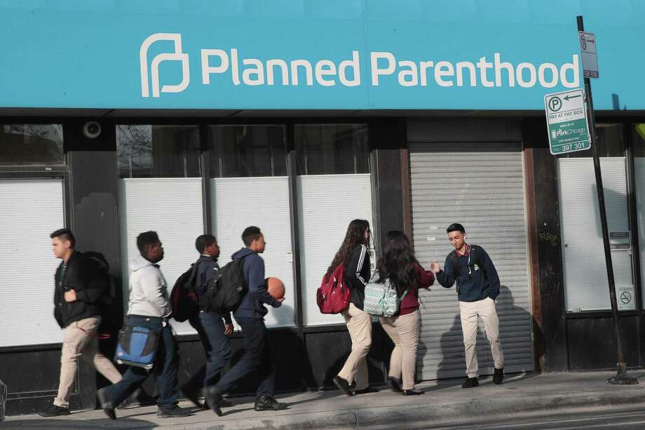 Pedestrians walk past a Planned Parenthood clinic on May 18 in Chicago, Illinois. The organization contends that a Trump administration rule change on Title X will limit women's access to abortions. Photo: Scott Olson /Getty Images / 2018 Getty Images