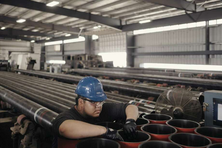 A worker inspects pipe at the Borusan Mannesmann factory in Baytown, Texas, May 3. Trump's imposition of tariffs on steel and aluminum from Canada and Mexico, Texas's top trade partners, will hurt the state. Photo: TODD SPOTH /NYT / NYTNS