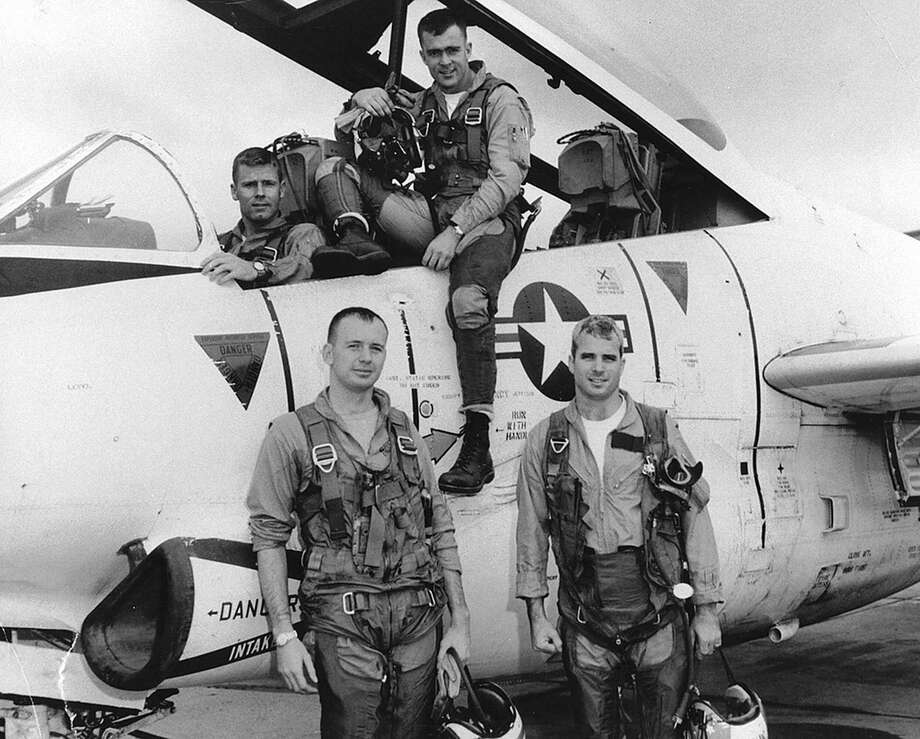 Sen. John McCain (front right), as a Navy pilot, stands with his squadron in 1965. McCain was shot down over Hanoi and taken prisoner. A reader praises his heroism. Photo: Library Of Congress / NYTNS