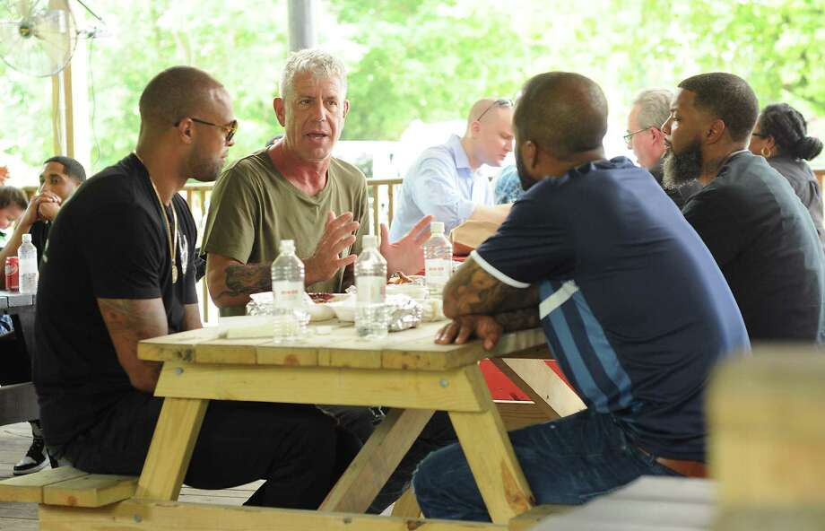 Anthony Bourdain, host of the popular CNN food show, Parts Unknown, is filmed at Burns Orginal Barbecue Friday June 10,2016. With Bourdain are Slim Thug, Red Bone and David Stunts.(Dave Rossman Photo) Photo: Dave Rossman, Freelance / For The Chronicle / Dave Rossman