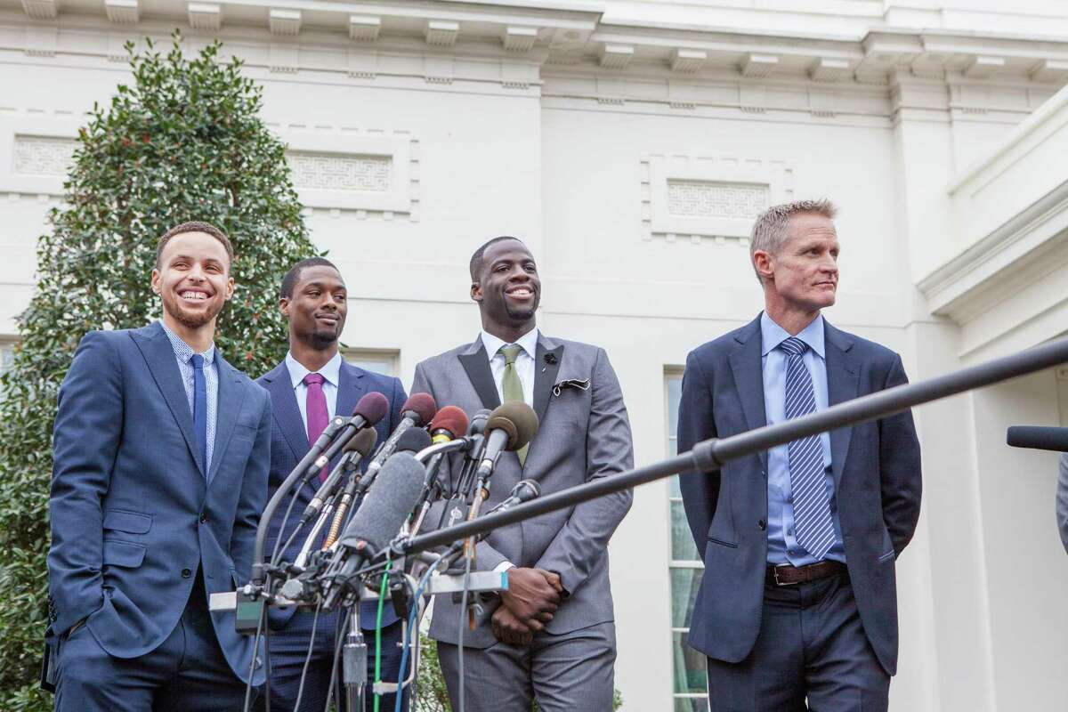 WASHINGTON, DC - On Thursday, February 4, from left to right, Golden State Warriors point guard Stephen Curry, Forward Harrison Barnes, Forward Draymond Green and Head coach Steve Kerr, answer questions from reporters outside of the West Wing of the White House. (Photo by Cheriss May/NurPhoto) (Photo by NurPhoto/NurPhoto via Getty Images)