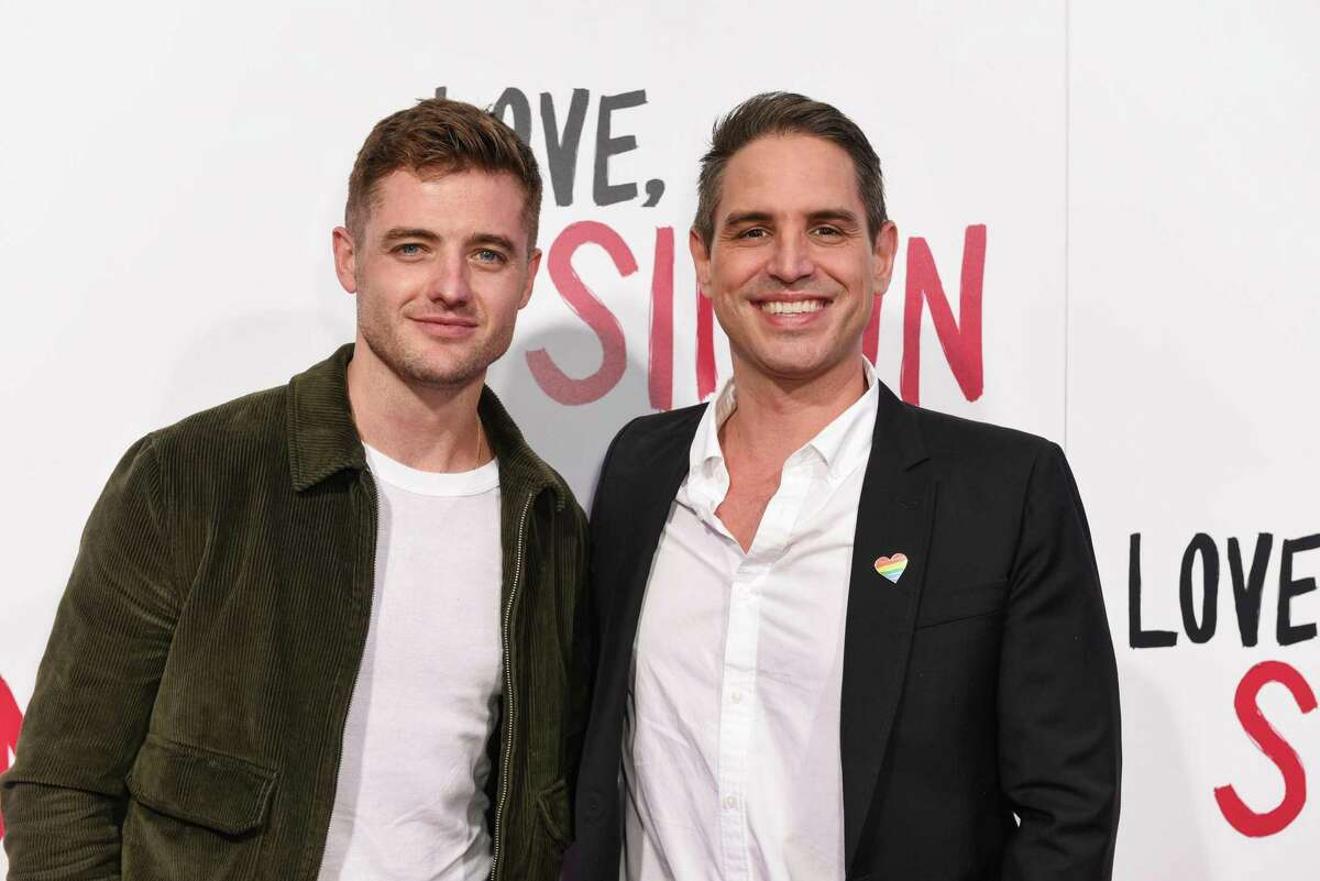 Greg Berlanti (right) appears with Robbie Rogers at a March screening of