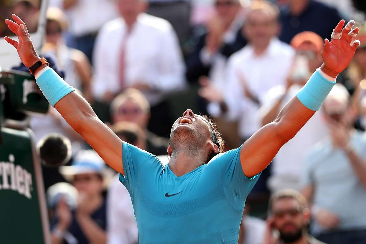 PARIS, FRANCE - JUNE 08: Rafael Nadal of Spain celebrates victory during his mens singles semi-final match against Juan Martin Del Potro of Argentina during day thirteen of the 2018 French Open at Roland Garros on June 8, 2018 in Paris, France. (Photo by Matthew Stockman/Getty Images)