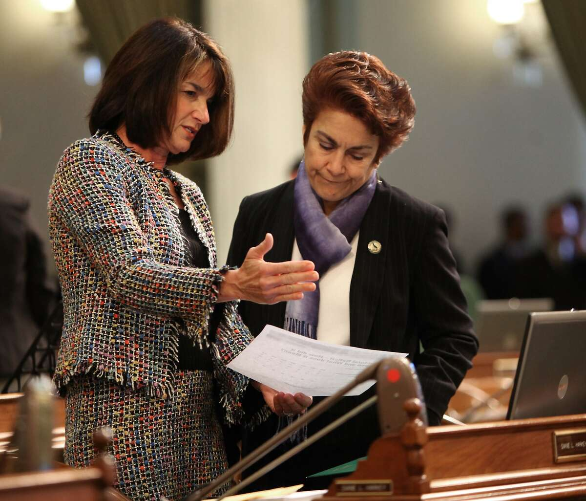 Assemblywoman Diane Harkey, R-Dana Point left, and Assemblywoman Anna Caballero, D-Salinas, look over information on the California's structural budget deficit at the Capitol in Sacramento, Calif., Monday, Feb. 22, 2010. Lawmakers in both houses are expected to vote on a Democratic package of bills designed to reduce California's $20 billion budget deficit by $5 billion.