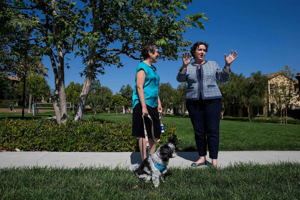 Katie Porter, right, a Democratic candidate for California�s 45th Congressional District, campaigns on primary day in Lake Forest, Calif., June 5, 2018. (Eric Thayer/The New York Times)