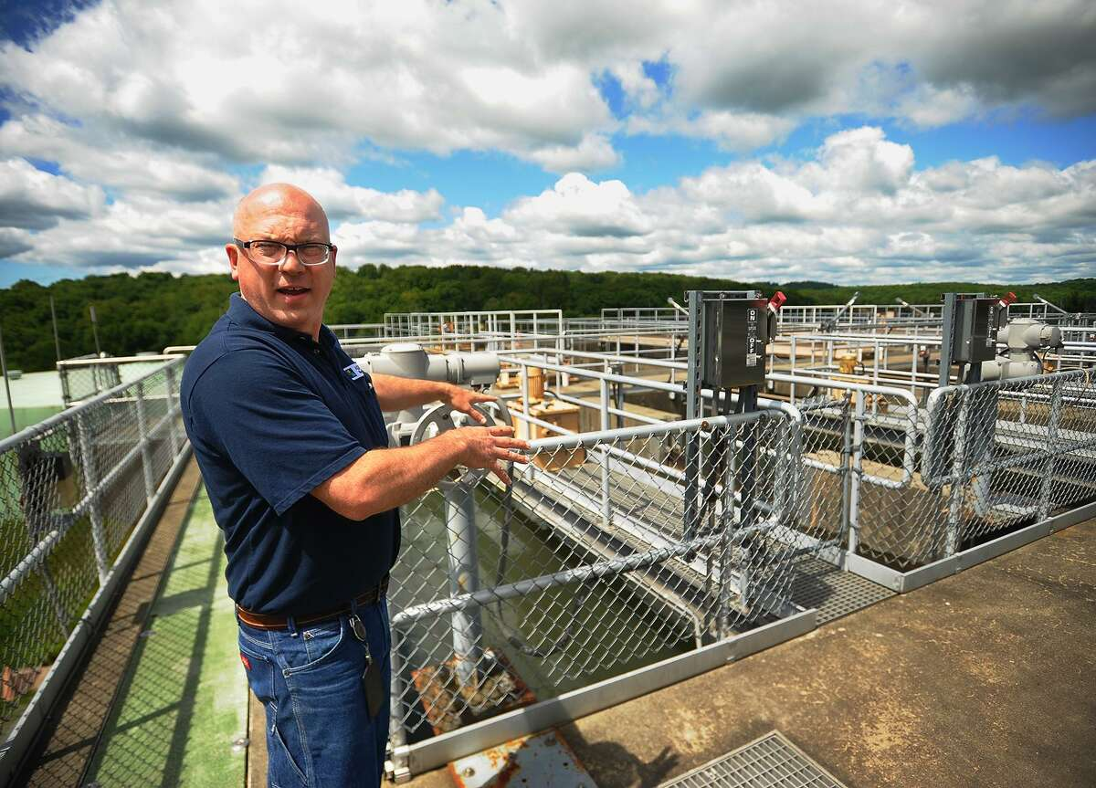 Senior Chief Operator Joe Welsh explains the operation of Aquarion's Easton Lake Water Treatment Plant in Easton, Conn. on Wednesday, June 6, 2018.