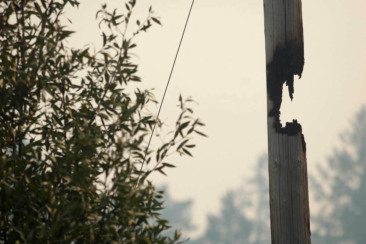 A partially burned through power pole along Lokoya raod after flames from the Nuns fire moved through the Mt Veeder area in Napa, California, USA 11 Oct 2017.