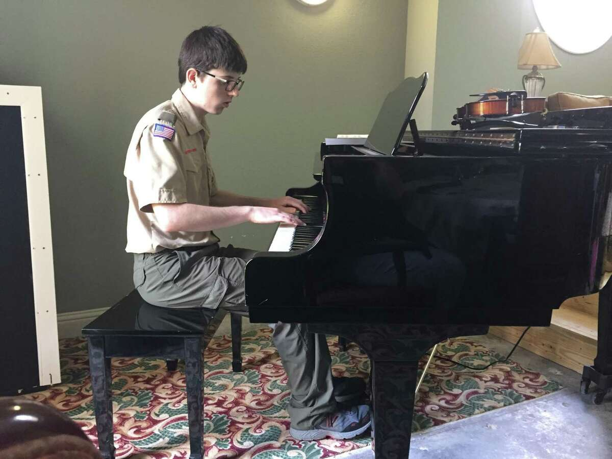 Clayton Smith, a Boy Scout, has played piano every Saturday at Parkway Place for seniors in order to earn a merit page.