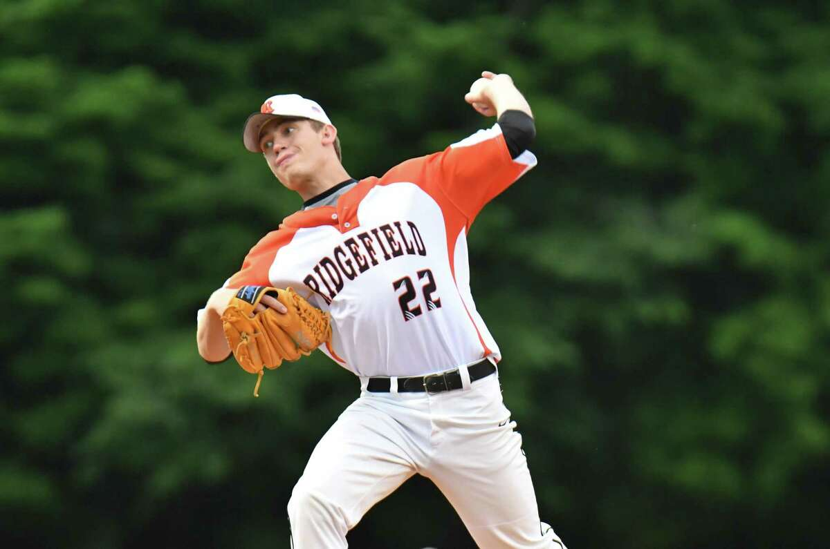 Alex Price of Ridgefield delivers a pitch during the Class LL baseball semifinal round against the Amity Spartans on Wednesday at Municipal Stadium in Waterbury.