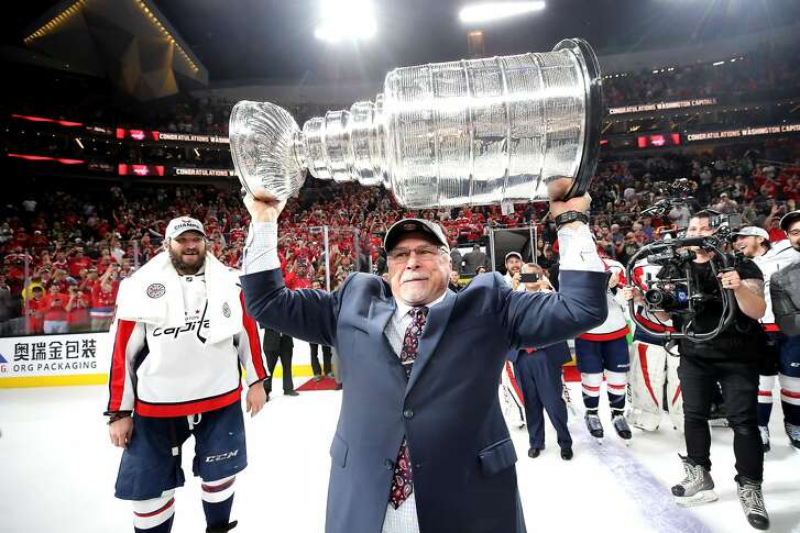 LAS VEGAS, NV - JUNE 07:  Head coach Barry Trotz of the Washington Capitals hoists the Stanley Cup after his team defeated the Vegas Golden Knights 4-3 in Game Five of the 2018 NHL Stanley Cup Final at T-Mobile Arena on June 7, 2018 in Las Vegas, Nevada.  (Photo by Bruce Bennett/Getty Images)