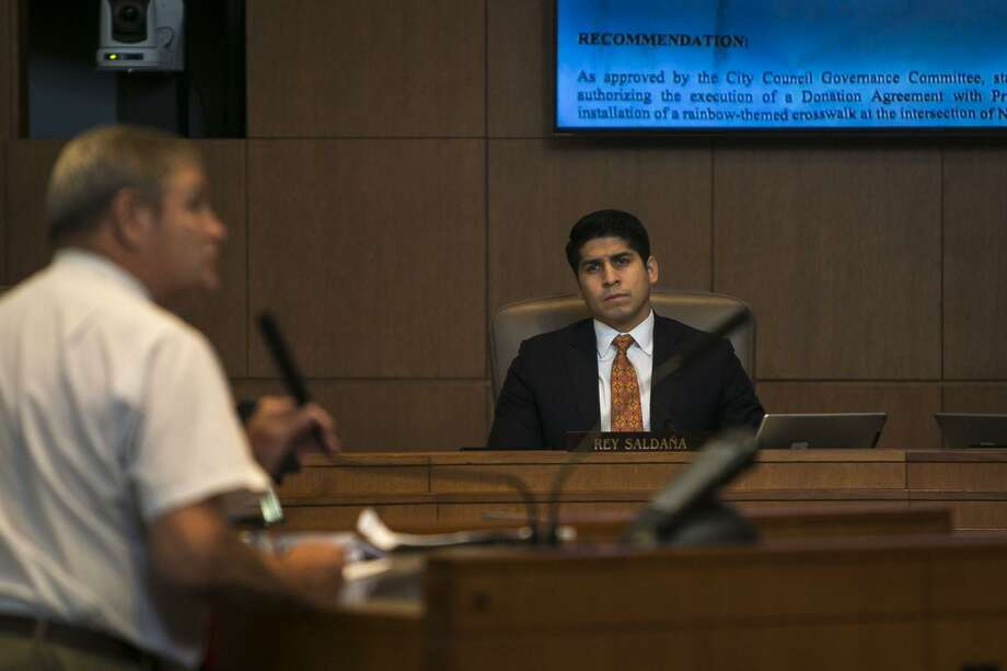 Councilman Rey Salda–a listens to Jack M. Finger as he speaks in opposition of the San Antonio City Council accepting about $20,000 in funding to install a permanent rainbow-colored crosswalk near downtown Thursday, June 7, 2018. Photo: Josie Norris, Staff / San Antonio Express-News / © San Antonio Express-News