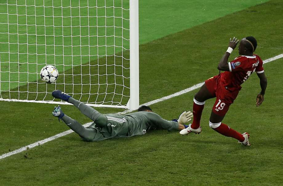 Liverpool's Sadio Mane scores during the Champions League Final against eventual winner Real Madrid in Kiev, Ukraine, on May 26. Photo: Darko Vojinovic / Associated Press