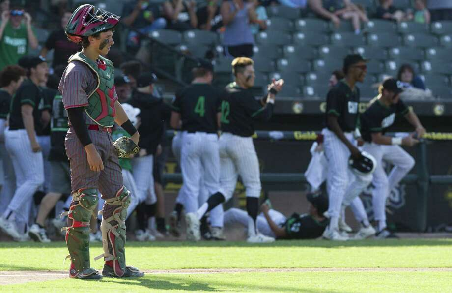 The Woodlands catcher Drew Romo looks on after Southlake Carroll took the lead in the sixth inning of a Class 6A state semifinal game during the UIL State Baseball Championships at Dell Diamond on Friday, June 8, 2018, in Round Rock. Photo: Jason Fochtman, Staff Photographer / Houston Chronicle / © 2018 Houston Chronicle