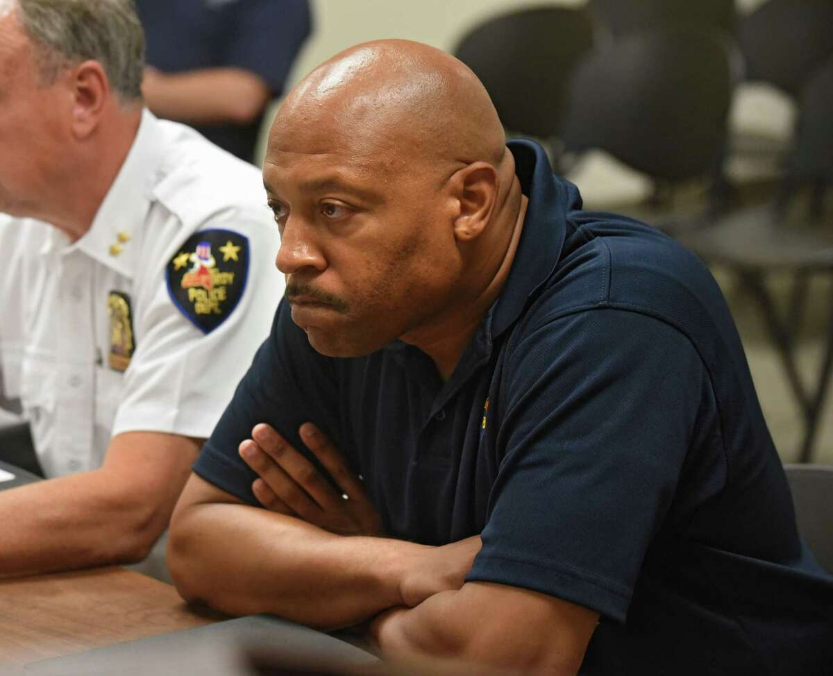 Aaron Collington, president of the Troy Police Benevolent Associatio, listens as Troy Police Chief John Tedesco speaks to the city council about the spate of shootings and fires that have plagued the city in recent weeks on Monday, July 24, 2017 at Troy City Court in Troy, N.Y. Collington, 49, was indicted on a charge of third-degree grand larceny. (Lori Van Buren/Times Union archive)